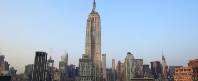 The Empire State Building stands above midtown New York