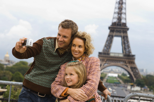 Family Sightseeing in Front of Eiffel Tower